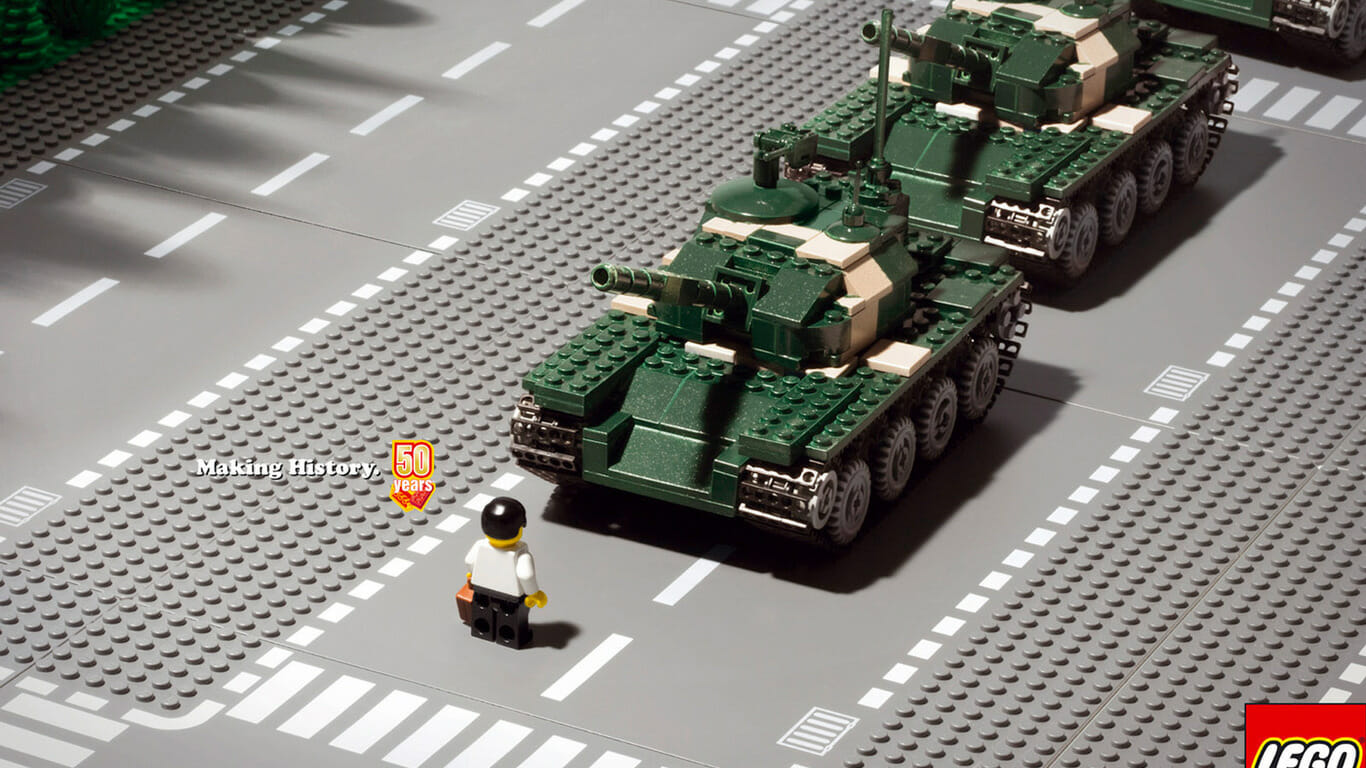 a man standing in front of the lego tanks